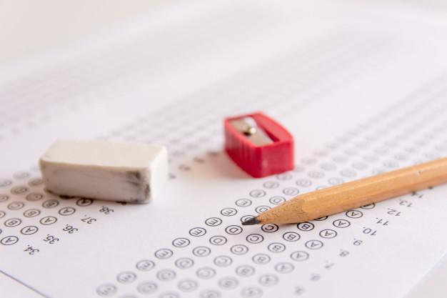 pencil-sharpener-and-eraser-on-answer-sheets-or-standardized-test-form_9635-362